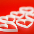 A lot of hearts on red background. — Stock Photo #6595212