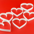 Stock Photo: A lot of hearts on red background.