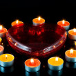 Heart , surrounded small candles. — Stock Photo #6595294
