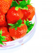 A heap of fresh strawberries in glass bowl . - Stok fotoğraf
