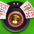 Royalty-Free Stock Photo: Royal flesh- playing cards on green broadcloth.
