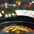 Casino roulette, dice and playing cards. - Stock Photo