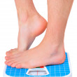 Man&#039;s legs ,which weighed on floor scale. Isolated - Stock Photo