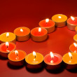Small light candles, in heart form . — Stock Photo #6596211