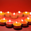 Small light candles, in heart form . — Stock Photo #6596212