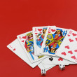 Playing cards on cololur broadcloth. - Stock Photo