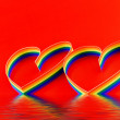 Single hearts, paint of a six-colour gay flag. — Stock Photo