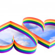 Two hearts, paint of a six-colour gay flag. — Stockfoto