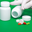 Medicine bottles, pills on colour background. - Foto Stock