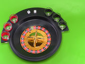 Casino roulette on green broadcloth. — Stock Photo