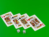 The dice and playing cards on green broadcloth. — Stock Photo