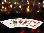 Dice and playing cards- poker royal flesh. — Stock Photo