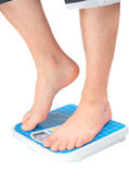 Man's legs ,which weighed on floor scale. Isolated — Stockfoto