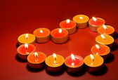Small light candles, in heart form . — Stockfoto