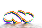 Two hearts, paint of a six-colour gay flag. — Stock Photo
