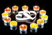 Two hearts, surrounded small candles. — Stok fotoğraf