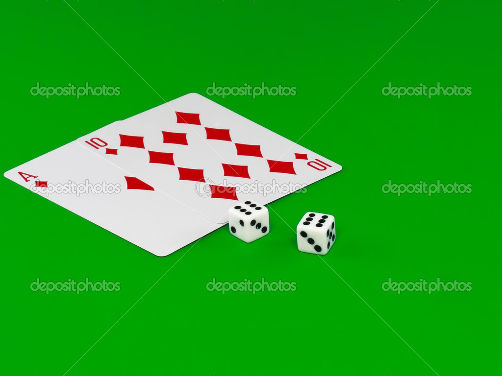 The dice and playing cards - Pip- 21 on green broadcloth.  Stock Photo #6595774