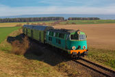 Passenger train passing through countryside — Stock Photo