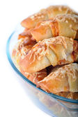Little croissants with ham and cheese — Stock Photo