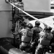 Soldiers marines ( sea commandos ) boarding a ship in a simulated assault. — Stock Photo #6608368