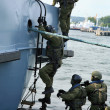 Stock Photo: Soldiers marines ( secommandos ) boarding ship in simulated assault.
