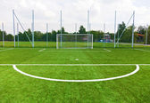 Football ground with goal gates — Stock Photo