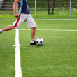 Soccer player kicking - Stock Photo