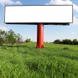 Blank billboard against blue sky - Stock Photo