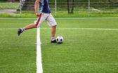 Soccer player kicking — Stock Photo