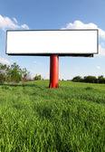 Blank billboard against blue sky — Stock Photo