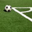A soccer ball in stadium, corner- selective focus - Foto Stock