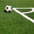 A soccer ball in stadium, corner- selective focus - Stockfoto