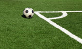 A soccer ball in stadium, corner- selective focus — Stock Photo