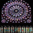 Stained glass window in Notre dame cathedral - Stock Photo
