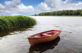 Old lonely fishing floating on the water — Stock Photo