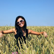 Wheat field and girl — Stock Photo
