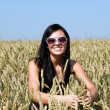 Stock Photo: Happy girl in wheat field