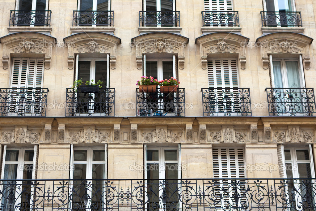 Apartment building with balcony in paris stock photo for Building balcony