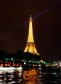 Eiffel Tower light beam show at the night — Stock Photo