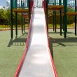 Colorful attractive playground and slide facilities — Stock Photo #5871853