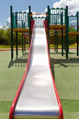 Colorful attractive playground and slide facilities — Stock Photo