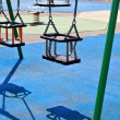 Playground swings - Stock Photo