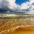Beach and stormy sea — Stock Photo