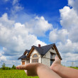 House in my hands - Stock Photo