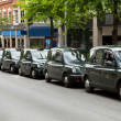 Taxis in UK - Stock Photo