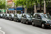 Taxis in UK — Stock Photo