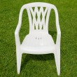 White chair in the garden — 图库照片
