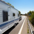 Caravan in the road - Stock Photo