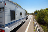 Caravan in the road — Stock Photo
