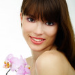 Woman with an orchid — Stock Photo #6145777